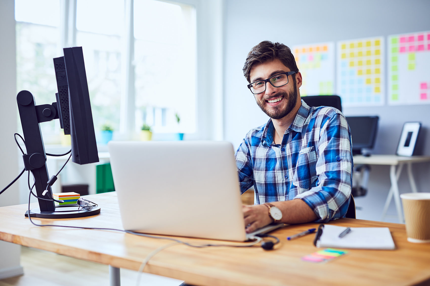 man smiling with laptop